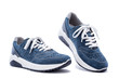 canvas print picture - Close up of elegant light blue sports shoes in natural nubuck leather for adult men photographed on a white background. Fashion accessories.