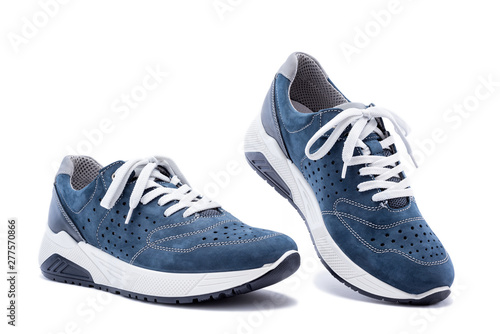 Photo  Close up of elegant light blue sports shoes in natural nubuck leather for adult men photographed on a white background