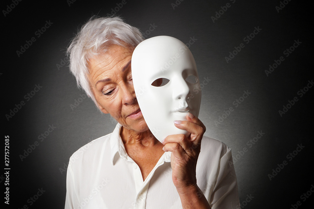 Fototapety, obrazy: older woman with white hair hiding sad face behind mask - depression or personality concept