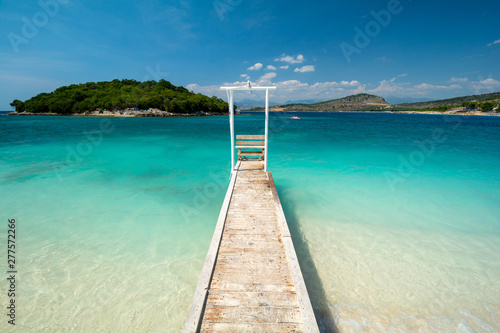 wooden pier on paradise beach in Ksamil in Albania Canvas Print