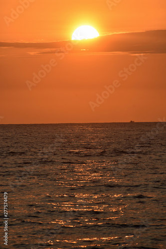Golden Sunset at the Beach with Boat