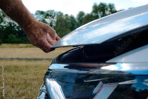 Fotografie, Obraz Opening the hood in the car