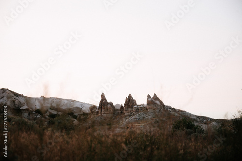 Valokuva  Rocks looking like mushrooms dramatically lit by a sunset in Cappadocia, Turkey