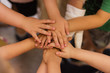 Children's hands piled on top of each other. Children's team and team building among the little guys