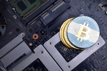 Golden Bitcoins With Flag Of Argentina On A Computer Electronic Circuit Board. Bitcoin Mining Concept.