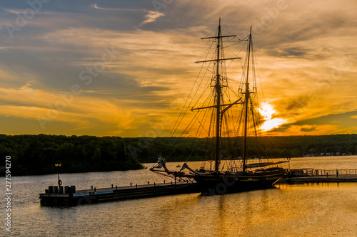 Fényképezés Two-masted brig moored at sunset at the pier