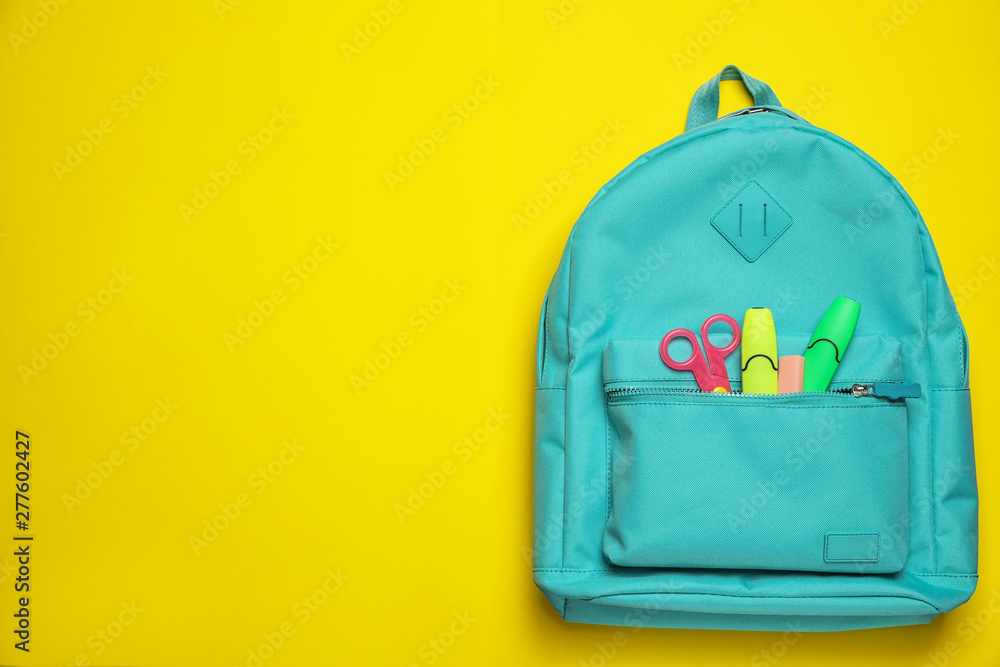 Fototapety, obrazy: Stylish backpack with different school stationary on yellow background, top view. Space for text