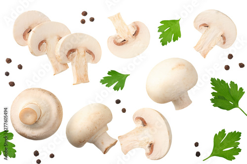 Cuadros en Lienzo mushrooms with slices, parsley leaf and peppercorns isolated on white background