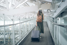 Asian Woman Traveler Walking Dragging Luggage To Travel To The Airport In Time To Board The Plane