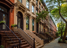 Scenic View Of A Classic Brooklyn Brownstone Block With A Long Facade And Ornate Stoop Balustrades On A Summer Day In Clinton Hills, Brooklyn
