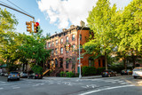 Fototapeta Nowy Jork - Clinton Hill, Brooklyn, United States - June 30, 2019: Historic brownstone building on beautiful summer evening in Clinton Hill, Brooklyn, New York.