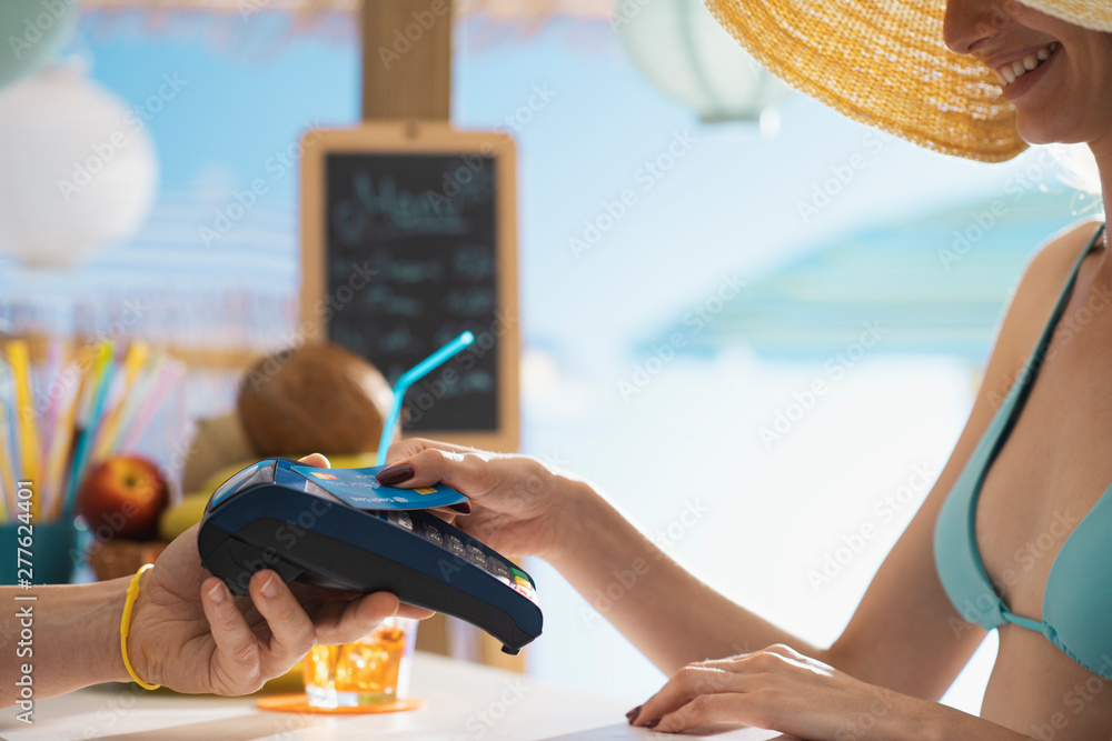 Fototapety, obrazy: Woman paying using a contactless credit card