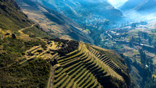 Aerial View Of The Ancient Inca Ruins Of Pisac (Pisaq) In The Sacred Valley Near Cusco, Peru. Archaeological Park With Green Terraces.