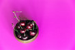 Leinwanddruck Bild - Fresh cherries in a small bowl on a bright pink background with copy space on the right