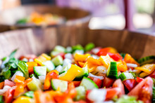 Closeup Of Macro Fresh Salad In Wooden Bowl Plate With Lettuce And Bell Peppers And Bokeh Background