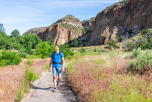 Main Loop Path Trail With Man Walking In Bandelier National Monument In New Mexico In Los Alamos With Canyon Cliffs