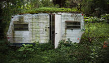 Abandoned Trailer In The Woods