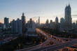 aerial view of buildings and highway interchange at dawn in Shanghai city