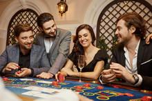 A Group Of People Gamblers In Casino Gambling