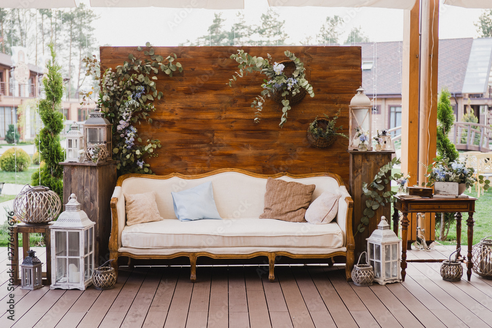 Fototapety, obrazy: Coziness and style. Modern event design. Lounge and photo zone and european traditional wedding ceremony decoration outdoors in the restaurant before the reception.