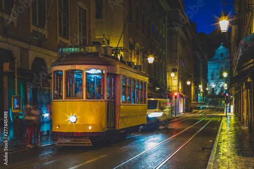 Fotografia, Obraz  tram on line 28 in lisbon, portugal at night