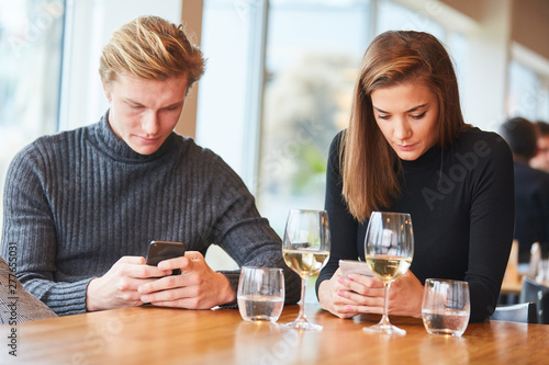 Fotografie, Obraz  Couple is silent with smartphone in hand