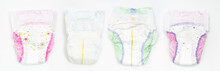 Set Of Disposable Baby Diapers Over White Background