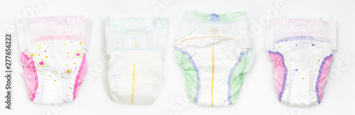 Photographie Set of Disposable Baby Diapers Over White Background