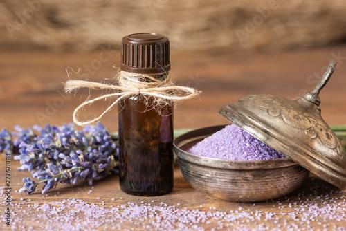 Lavender flowers, bath salt and lavender oil on a wooden background. - 277678818