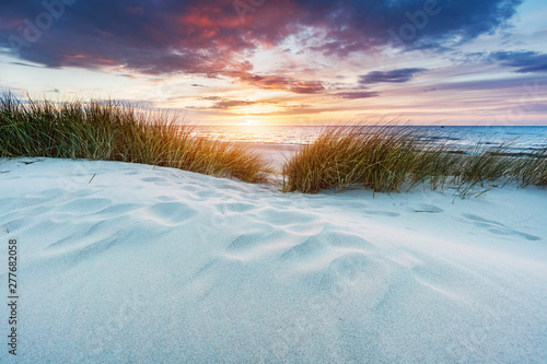 Grassy dunes and the Baltic sea at sunset Tapéta, Fotótapéta