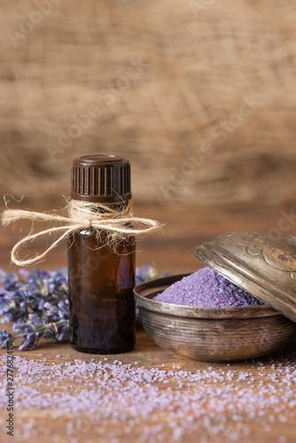 Lavender flowers, bath salt and lavender oil on a wooden background. - 277682415
