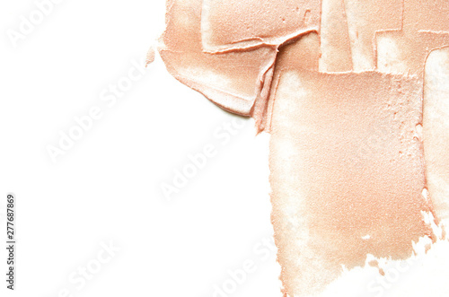 Vászonkép  Beige smears of crushed highlighter or luminizer. - Image