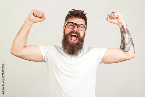 Screaming bearded brutal man with hands up Tableau sur Toile