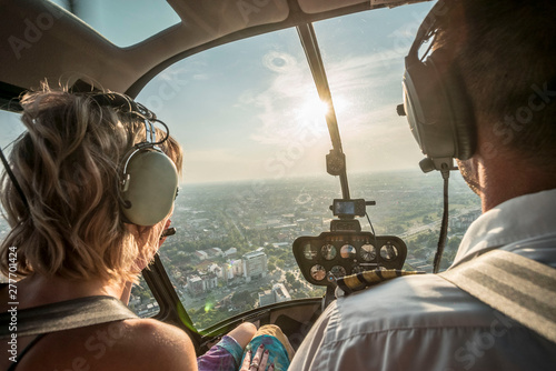 Portrait of beautiful blonde women and pilot enjoying helicopter flight Tapéta, Fotótapéta