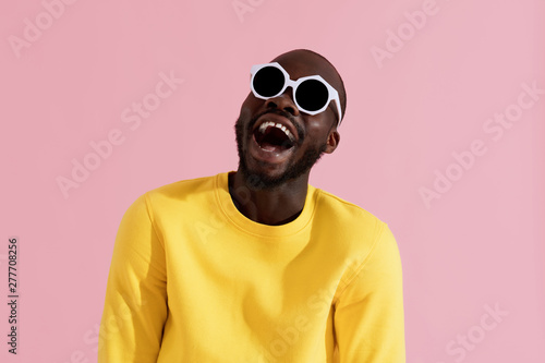 Deurstickers Snelle auto s Fashion. Smiling black man in sunglasses colorful portrait