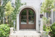 Elegant Wooden Front Door Surrounded By Garden