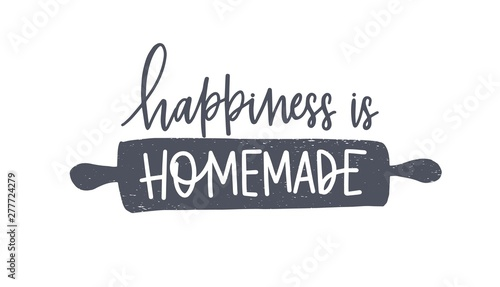 Photo Happiness Is Homemade phrase handwritten with cursive calligraphic font or script on rolling pin