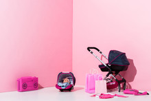 Baby Carriage, Doll In Baby Carrier, Shopping Bags And Boombox On Pink