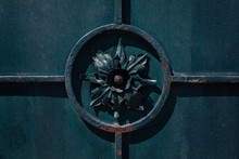 Detail Of Old Wrought Iron Fence, Dark Flower In The Circle