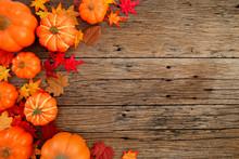 Autumn Leaves On Wooden Backgr...