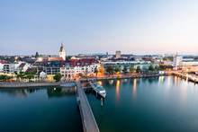 """Friedrichshafen, Baden-W¸rttemberg, Germany:  View Over The City And Harbor From The """"Moleturm"""" Lookout Tower At The Harbor In Friedrichsafen During Sunrise."""