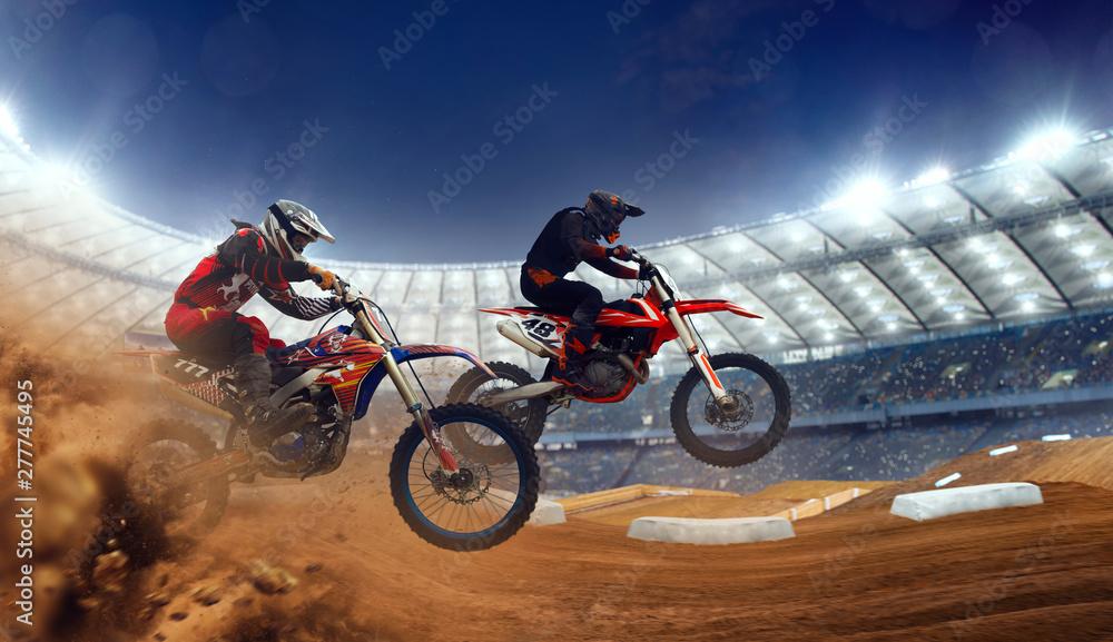 Fototapeta Motocross riders in action. Supercross. Motocross sport.
