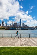 A Woman Runs Along The Hudson ...