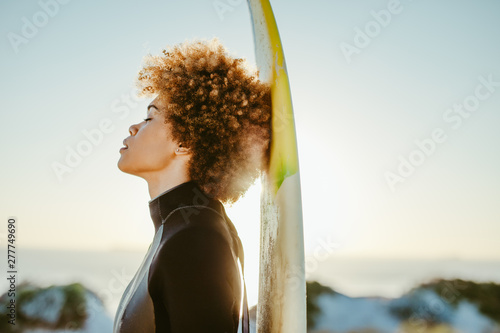 Female relaxing after surfing in the sea Canvas Print