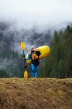 A Female Kayaker With A Drysuit And Full Boating Gear At The Three River Motel Along The Lochsa River In Idaho. Fog From Typical Lochsa Weather Drifts By In The Background.