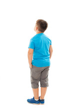 Adorable Little Boy Looking At Wall Hands In Pocket. Rear View, Isolated On White Background