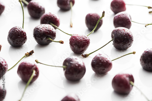 selective focus of fresh, whole and ripe cherries covered with water drops