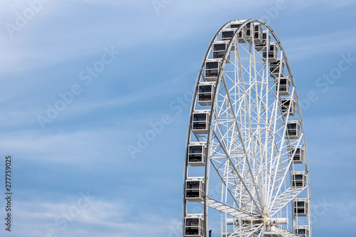 Panoramic wheel on a light blue sky background.