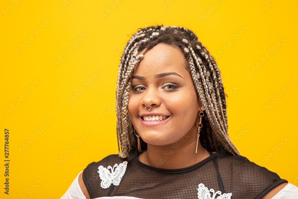 Fototapety, obrazy: Beautiful young african american woman with dread hair on yellow background