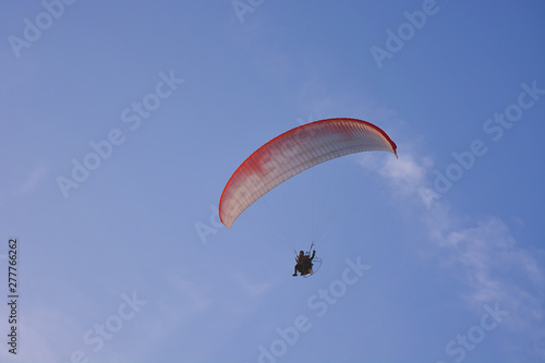 Paramotor (Powered Paraglider) With Red-White Parachute Flying In Sky, Extreme Sport Wallpaper Mural